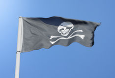 Pirate skull. With crossbones flag Stock Image