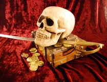 Pirate skull and booty. Pirate Skull with eye sockets and teeth with gold and other booty Stock Image