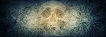 Pirate skull and compasses on old grunge paper background royalty free stock image