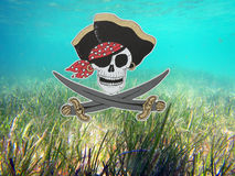 Pirate skull. A pirate composition under water royalty free stock image