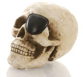 Pirate skull with eye patch Royalty Free Stock Photos