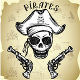 Pirate skull with hat and pistols Stock Photo