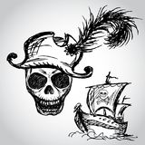 Pirate skull with hat and pirate ship Stock Photos