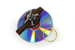 Pirate software. Pirate Skull with gold earring and purple dvds with red interiors Royalty Free Stock Image