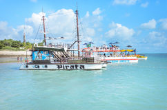 Pirate-themed boat that transports tourists on beautiful beach with blue water on a sunny day Stock Photography