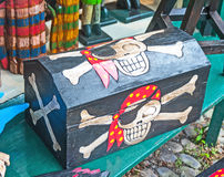 Pirate treasure chest. Black chest decorated with skull and cross-bones made for pirates with a touch of Halloween royalty free stock photos