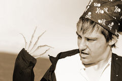 Pirate Turning Undead. Duotone Image Of A Startled Pirate Moving His Skeleton Finger In Shock Horror As He Starts To Turn Into The Undead In A Death And Decay Stock Photography