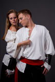 Pirate & Wench. Couple posing in pirate costumes Stock Photography