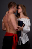Pirate & Wench. Couple posing in pirate costumes Royalty Free Stock Photo