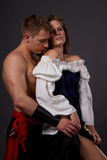 Pirate & Wench. Couple posing in pirate costumes Stock Image