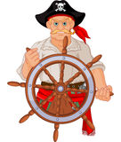 Pirate at the wheel Stock Images