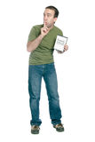 Pirated Computer Software. A young man holding a dvd case with pirated computer software in it and telling someone to shhh, isolated against a white background Stock Photo