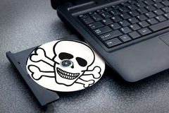 Pirated disc in notebook Royalty Free Stock Photo