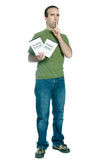 Pirated Movies and Software. Full length view of a young man holding 2 dvd cases of bootlegged movies and software, isolated against a white background Stock Images