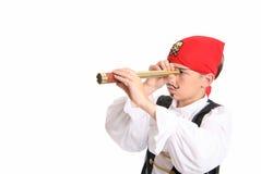 Piratería - pirata que busca para el botín fotografía de archivo