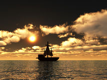Pirates 2. An image of a pirate ship sailing on the ocean,with a sunset in the background Royalty Free Stock Image