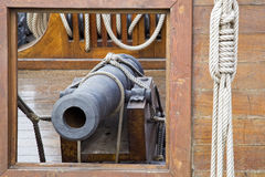 Pirates. Cannon in an old pirate sailing ship Stock Photography