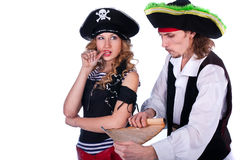Pirates. Two pirate men and a women holding a map in his hands Royalty Free Stock Image