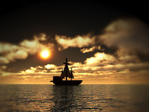 Pirates 3. An image of a pirate ship sailing on the ocean,with a sunset in the background Stock Photo