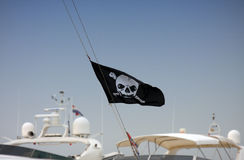 Pirates. Flag on the modern yacht Stock Images