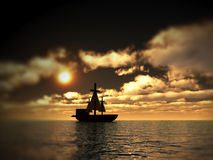 Pirates 6. An image of a pirate ship sailing on the ocean,with a sunset in the background Stock Image