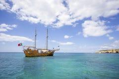 Pirates boat for tourists sailing along Algarvian shore, Portuga stock photography