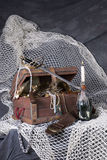 Pirates cafe. A horizontal image of pirates items on a fishing net Stock Photo