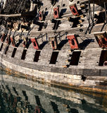 Pirates cannons. Reflection of the cannons on the pirate ship in Genoa royalty free stock image
