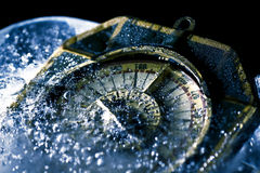 Pirates compass in ice Stock Photos