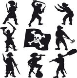 Pirates crew silhouettes. Silhouettes pirate crew with a Jolly Roger flag Royalty Free Stock Photo