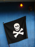 Pirates flag. On the blue wall Royalty Free Stock Photo