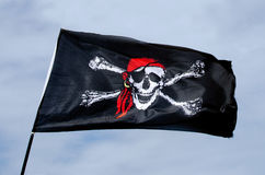 Pirates flag. Jolly Roger, Pirates flag against blue sky Stock Photography