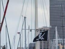 Pirates flag among masts Stock Photos