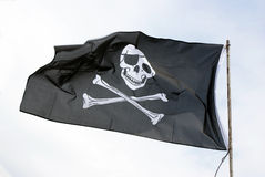 Pirates flag with skull and bones-cross. Black pirates flag announcing an attack Stock Photography