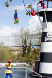 Pirates jumping off lighthouse in Lego Land show. Legoland pirate show Stock Photography