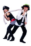 Pirates in a man and a woman pulling a rope Stock Images