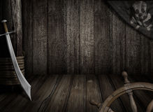 Pirates ship background with old jolly roger flag and saber Stock Images