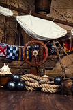 Pirates ship deck with steering wheel and flag Royalty Free Stock Photo