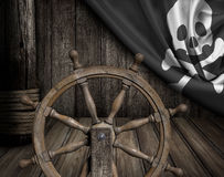 Pirates ship deck with steering wheel and flag Stock Image