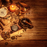 Pirates treasure border. Glass with wine and cigars for filibuster, map with way to treasures island, golden coins, antique accessories, crime and piracy Royalty Free Stock Image