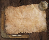 Pirates treasure map on old wooden desk 3d illustration Stock Photos