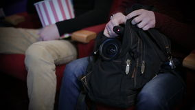 Pirating at the cinema, hidding camera in a bag stock video footage