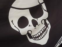 Piratkopiera flaggadetaljen Arkivbild
