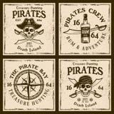 Piratkopierar fyra färgade emblem eller t-skjorta tryck Stock Illustrationer
