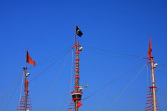 Pirats flag. Pirates flag on the flagpole with blue sky Stock Images