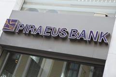 Pireaus Bank branch sign. Heraklion, Crete, Greece - July 27, 2010: The sign on a branch of Piraeus Bank in Heraklion (Iraklio), Crete. This bank is among those Stock Photos