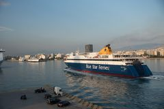 Pireaus Greece/ June 18, 2018: Ferry arriving in Pireaus Harbor Greece. Pireaus Greece/ June 18, 2018: Ferry arriving in port of Pireaus Greece in morning royalty free stock photos