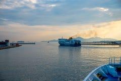 Pireaus Greece/ June 18, 2018: Ferry leaving in Pireaus Harbor G royalty free stock image