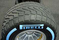 Pirelli F1 Race tyres. Pirelli Formula One race tyres on OZ race wheels on stands in the paddock. Deeply grooved Pirelli full wet f1 race tyre Stock Photo
