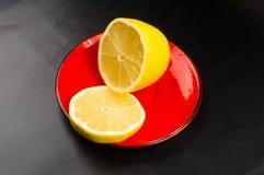 pires vermelhos de fatias do limão Foto de Stock